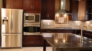 shaker style cabinets in a espresso finish granite