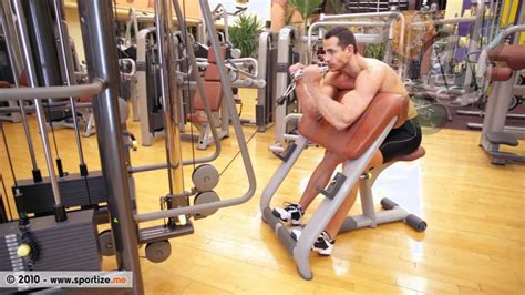 scott bench curls seated arm curl on scott bench with angled bar on a low