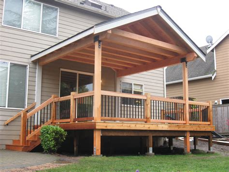 Fir timber framed roof cover over cedar deck. Built by