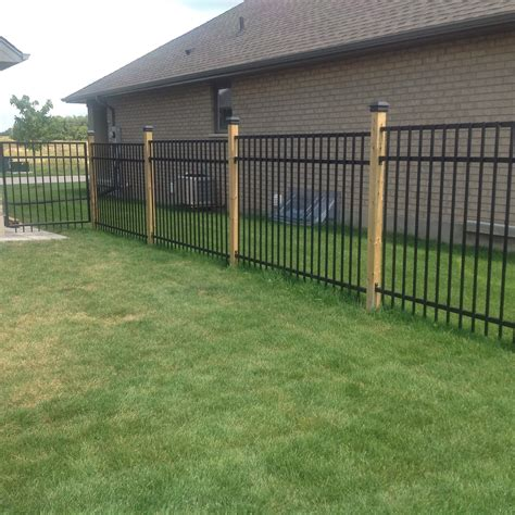 wood and metal fence wrought iron fence with 4x4 wood posts black caps
