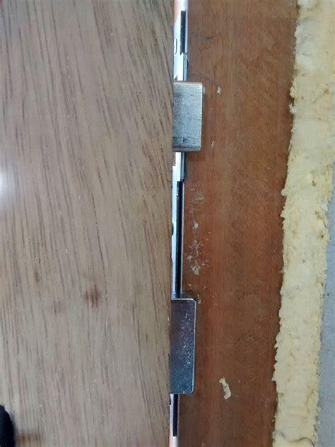 gap door how much gap is allowed between the door and striker plate