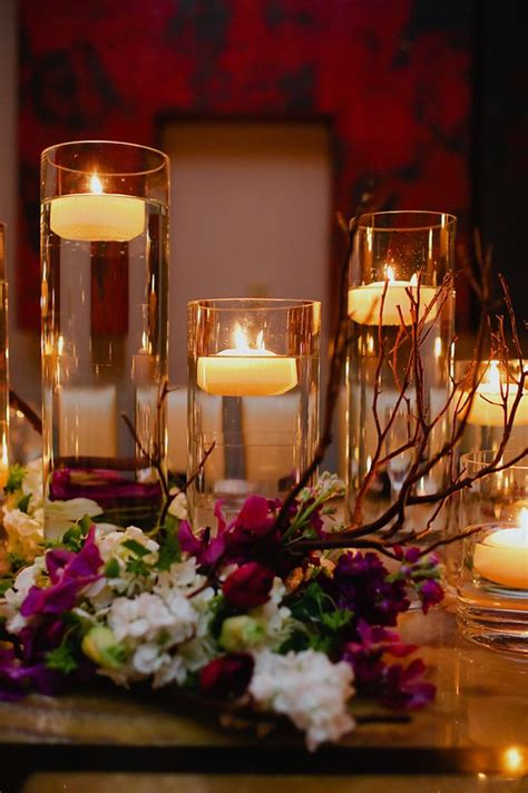 wedding centerpieces with flowers and floating candles floating candles centerpiece wedloft candles floating on water in clear vases wedding