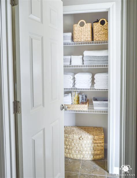 Linen Closet With by Organized Bathroom Linen Closet Anyone Can Kelley Nan