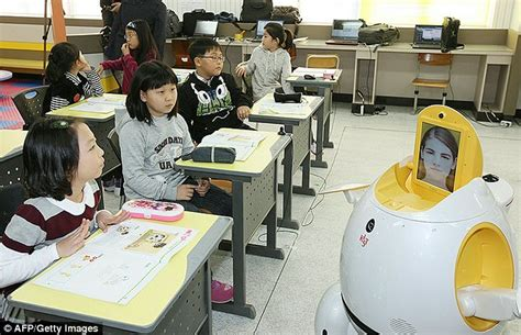film with robot teachers robot teachers with human faces roll into the classroom to