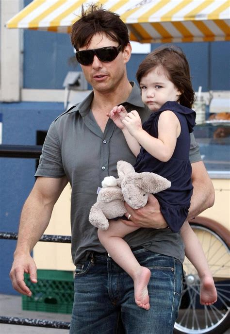 tom and suri cruise win a night at the cinderella castle suite in suri cruise photos tom cruise and suri spending some