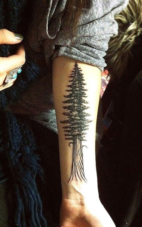 pine tree wrist tattoo wrist ink black clean trend tree simple