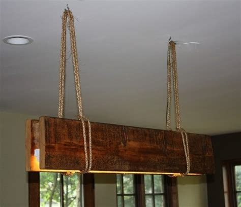 rustic reclaimed wood suspended l rustic chandeliers montreal by aes mobile studios