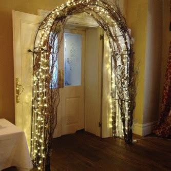 wedding arch  lights flowers  covered