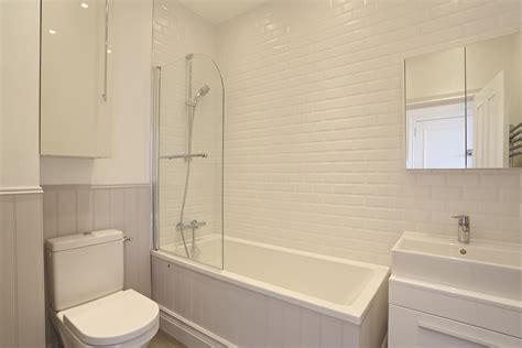 bathroom with paneling before and after project management and interior design