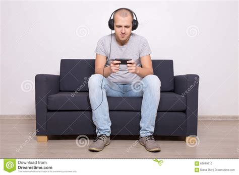 mobile couch man on couch playing games or watching movie on mobile