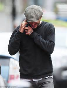 David Beckham Tattoo London | david beckham smiles as he chats on his phone in london