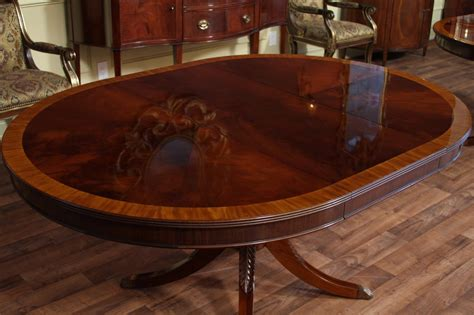 """48"""" Round to 66"""" Oval Mahogany Dining Table, Reproduction"""
