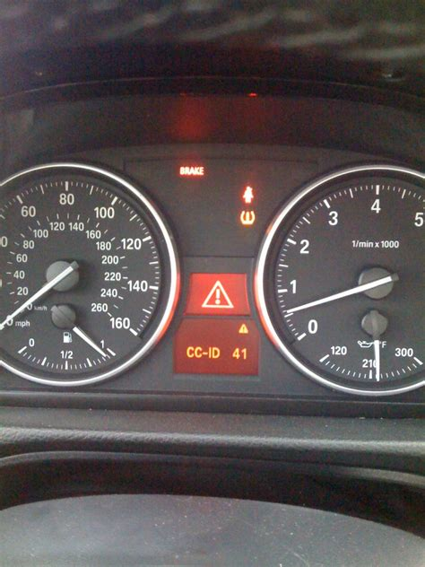 what does service engine light mean what does the triangle service light mean in a bmw autos