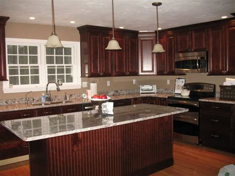 dark kitchen cabinets with light granite countertops cherry cabinets with new caledonia granite countertops