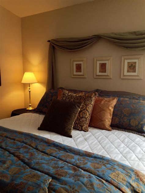 Curtain Headboards by Diy Headboard Made From Window Scarf Arranged On A Curtain Rod Hung Above Guest Room Bed