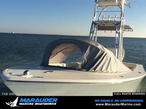 center console boats with stepped hull photo of boat with front tent cover protection marauder