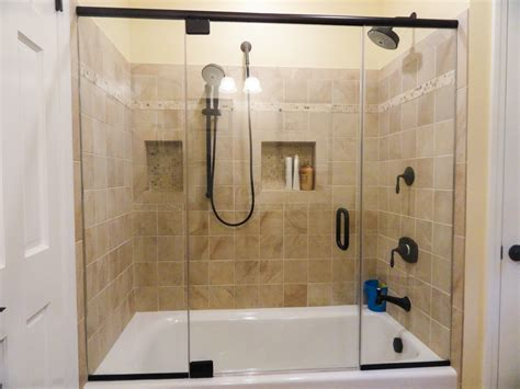 bathroom with glass doors tub showers