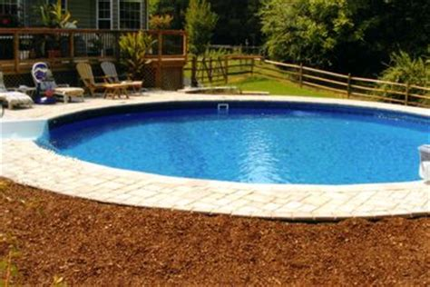 deck stairs above ground pool and ground pools on