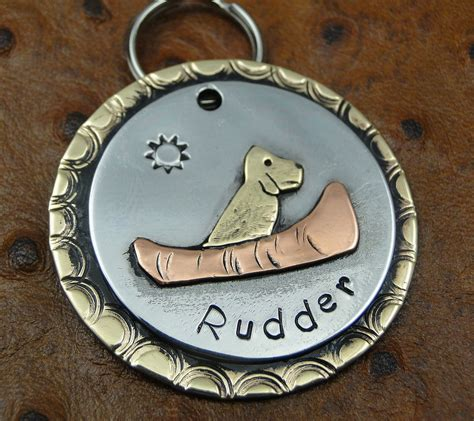 Handmade Pet Tags - putting on the custom pet accessories made by