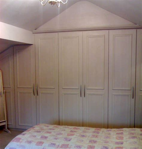 Angled Wardrobe Doors by 82 Angled Wardrobe Doors Angled Wardrobe With Doors Built Around Roof Beam In Pearl White