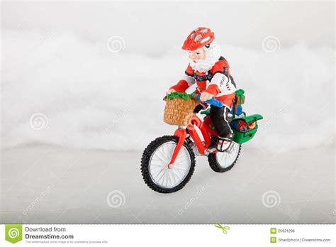 miniature santa claus on bike stock photo image 25621296