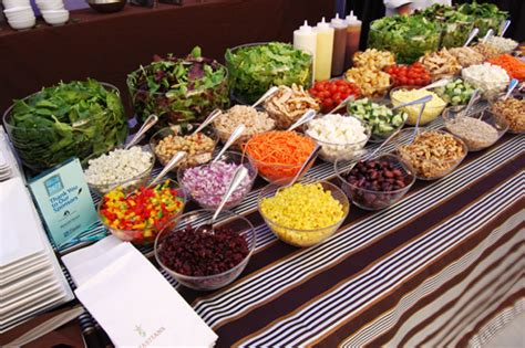 buffet items ideas chefs tossed various fresh items in front of guests at a