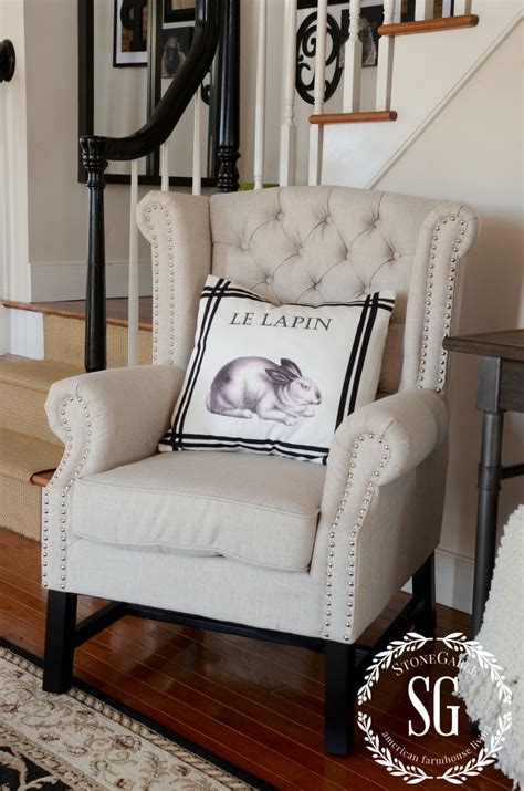 adding an upholstered chair to the foyer breaking the