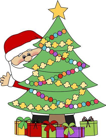 images of christmas clipart christmas clip art santa behind a christmas tree clip art