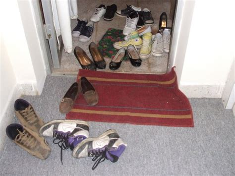 shoes off in the house it s traditional to take off your shoes before going into a house photo