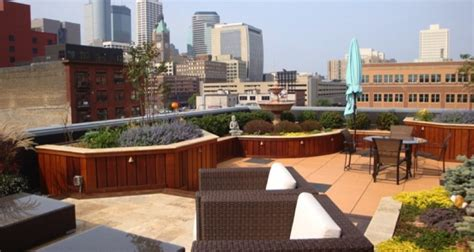 Minneapolis Patios by Travertine Patio Surrounded By Rooftop Garden In Downtown