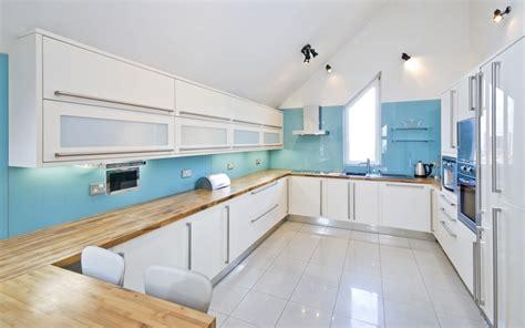 light blue accents give this white kitchen backsplash a 27 blue kitchen ideas pictures of decor paint cabinet
