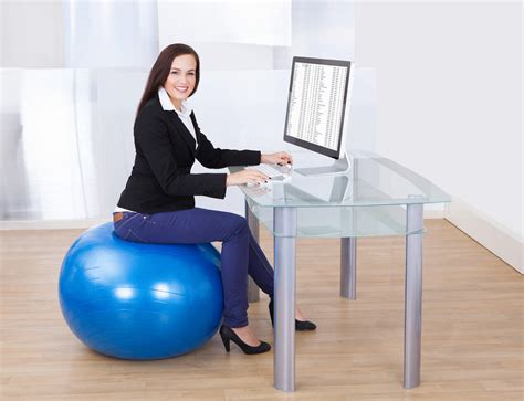 sitting on exercise ball at desk 8 desk exercises to boost your energy before you reach for