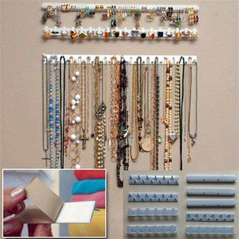 Murah Grosir Hanging Jewelry Organizer Accecories Display Hanging Tem new arrival adhesive jewelry display hanging earring necklace ring hanger holder packaging