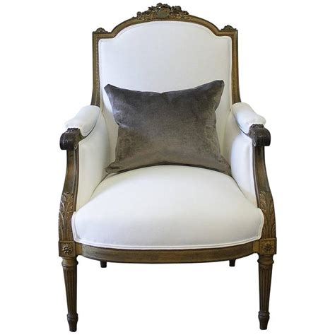 bergere chair antique louis xvi style giltwood bergere chair in white linen for sale at 1stdibs