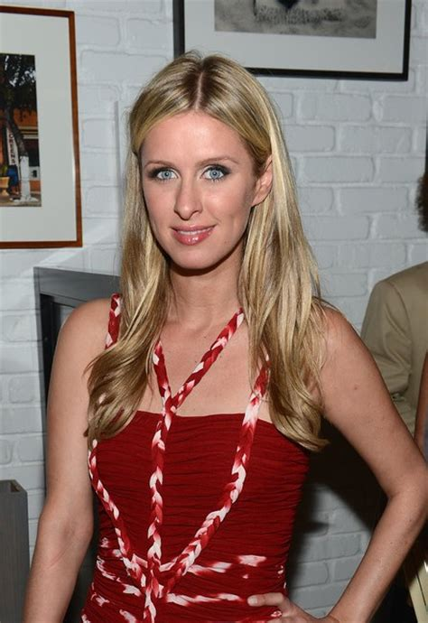 updo for hoteliers sleek blond nicky hilton long center parted hairstyle