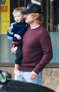 Owen Wilson carries his tired son Robert Ford in his arms