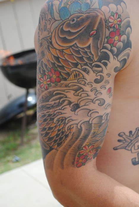 koi tattoo pictures arm koi fish arm tattoo desing tattooshunt com