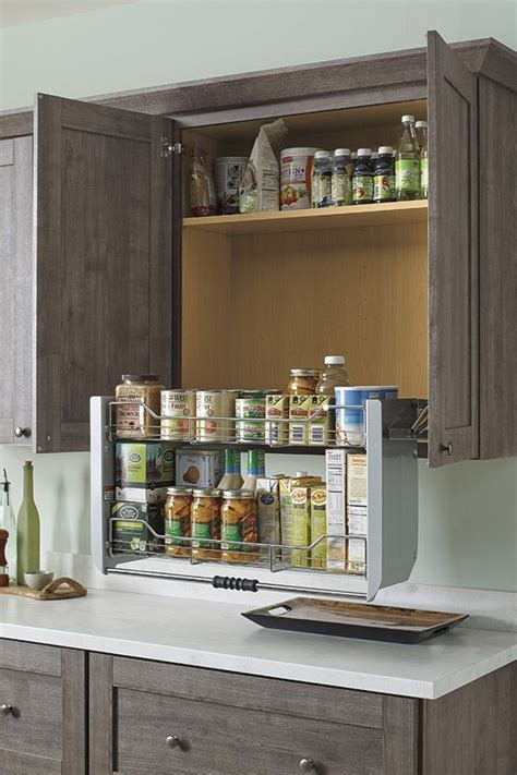 pull down kitchen cabinets our two tiered pull down cabinet shelf brings items in