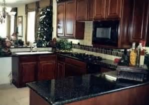 dark kitchen cabinets with dark countertops dark granite dark cabinets 043 granite verde butterfly