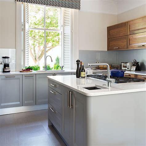 Pendant Light Over Kitchen Sink pale grey kitchen with walnut units decorating