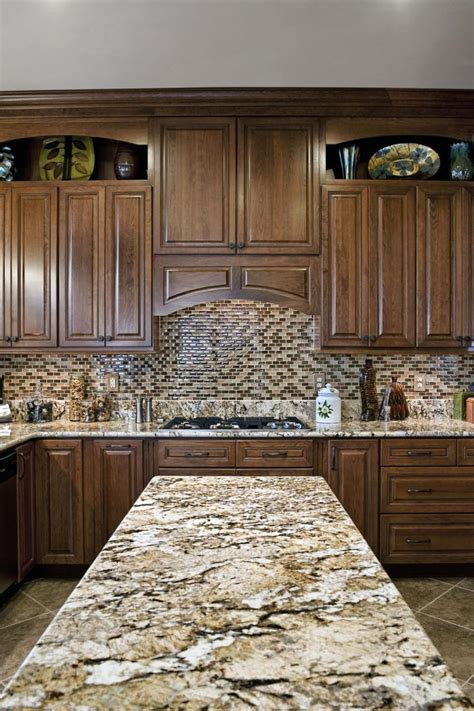 thomasville kitchen islands brown granite countertop brown tiled backsplash wood