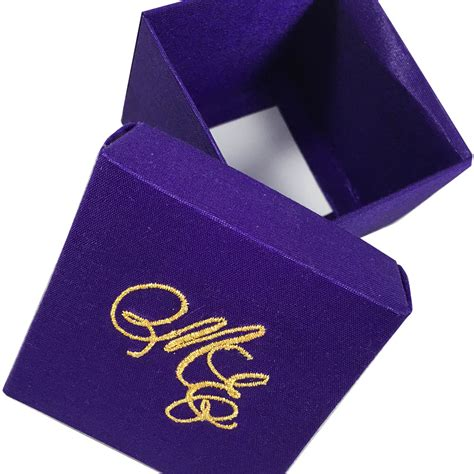 purple wedding invitations boxes purple wedding favour box with golden monogram embroidery