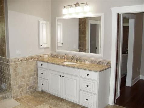 bathroom  beige painted walls  white cabinet vanity