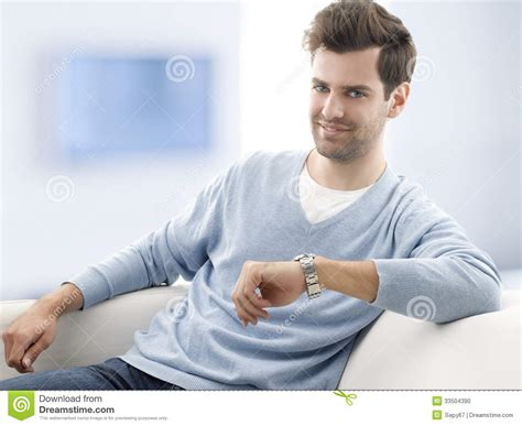 man sitting on couch young man sitting on sofa stock photo image 33504390