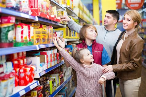Time To Actually Buy Groceries by Family Buying Groceries In Supermarket Stock Image Image