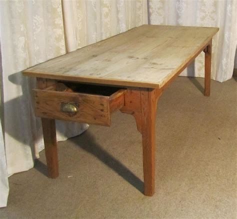 a large pine scrub top farmhouse kitchen table