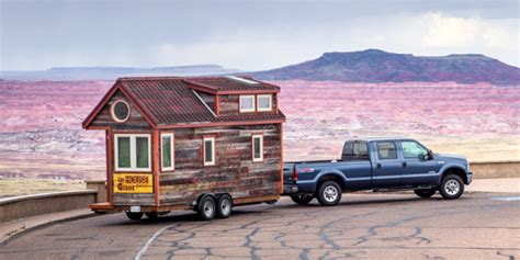 bid on travel quits day builds quaint tiny home on wheels