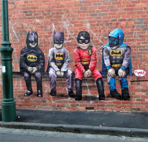 street art random cool children in batman costumes graffiti
