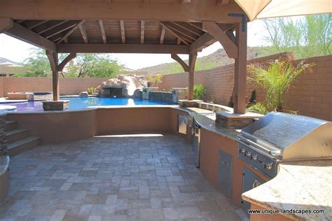 backyard designs with pool and outdoor kitchen daytime view steps lead to the pool open area for a