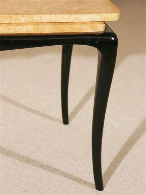a birds eye maple burr coffee table on ebonised base at